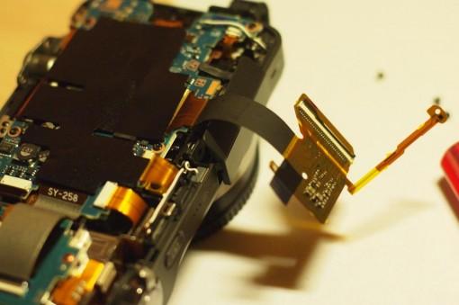 Rimozione scheda madre Sony NEX-3